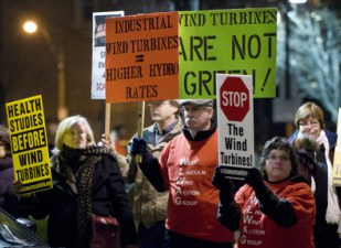 Hamilton, Ontario 29NOV10 _JLR1230.jpg Protesters against wind turbines and other causes carry signs outside Liuna Station Monday during the Liberal Trillium dinner. John Rennison, The Hamilton Spectator