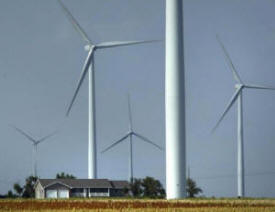 house-surrounded-by-wind-turbines